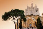 Tibidabo church on mountain in Barcelona with christ statue overviewing the city