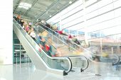 stock photo of escalator  - People rushing to work on escalators in business center - JPG