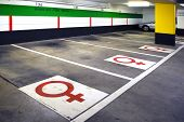 Underground parking with female only symbols in Cologne, Germany : positive discrimination for women safety