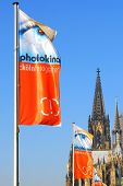 COLOGNE, GERMANY SEPTEMBER 2008: Announcement flags for biggest european photography exhibition Photokina with famous cathedral in the background, september 2008 in Cologne, Germany