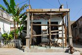 Reconstruction of a damaged house after hurricane in colonial town Baracoa, Cuba