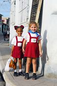 CAMAGUEY,CUBA- CIRCA NOVEMBER 2008: Unidentified schoolgirls in red school uniform in the city of Camaguey, Cuba circa November 2008. The town was designated a UNESCO World Heritage Site in July 2008.