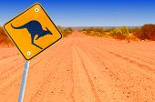 picture of oz  - Australian kangaroo roadsign in red outback landscape - JPG
