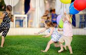 Little Boy And Girl Having Fun During Celebrating Birthday Party. Happy Child With With Colorful Bal poster