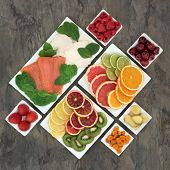 Stress and anxiety relieving fresh food with salmon, chicken, fruit and vegetables in porcelain dish poster