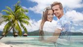 summer holidays, love and travel concept - happy smiling young hippie couple fading over tropical be poster