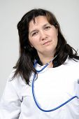 Doctor isolated on grey, beautiful nurse woman, healthcare photo