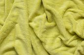 Soft Green Fabric With Waves And Folds. Soft Textile Texture. Folds On The Soft Fabric. poster