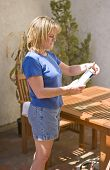 Woman Reading Instructions To Seal A Table