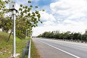 Speed Trap Surveillance Camera Along Highway To Control Speeding poster