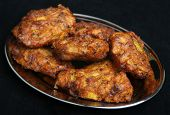 Indian onion bhajis on tray.