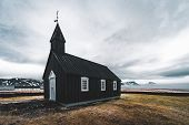 Famous Picturesque Black Church Of Budir At Snaefellsnes Peninsula Region In Iceland During A Heavy  poster