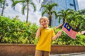 Boy Travels In Malaysia With Malaysia Flag Celebrating The Malaysia Independence Day And Malaysia Da poster