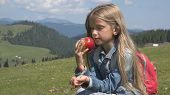 Child Portrait Eating Apples In Mountains, Hungry Girl At Picnic In Camping 4k poster
