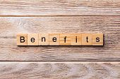 Benefits Word Written On Wood Block. Benefits Text On Wooden Table For Your Desing, Concept poster