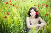 picture of teenage girl  - Young beautiful woman in spring field - JPG
