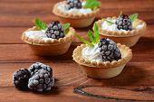 Delicious Tartlets On A Wooden Background. Blackberry With Cream - Dessert.healthy Homemade Berry De poster
