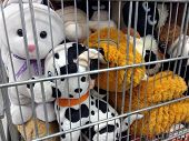 Different Soft Toys. Different Soft Toys In A Container In A Store.soft Toys In An Iron Cage. poster