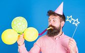 Hipster With Star Shaped Glasses Blows Into Party Horn. Surprise Concept. Guy In Party Hat With Holi poster
