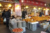 HANGZHOU, CHINA - NOVEMBER 26: Morning shoppers buy fresh farm produce in a wet market on November 26, 2011 in Hangzhou, China. Traditionally, men in Hangzhou shop and cook in the kitchen at home.