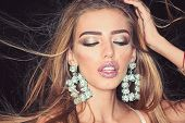 Fashion Model With Trendy Look. Glamour Jewelry Of Luxury Big Earrings. Girl With Sexy Lips Makeup.  poster