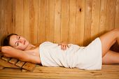 stock photo of sauna woman  - Young woman relaxing in a sauna - JPG