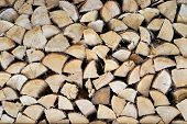 The Firewood Combined In Two Ranks For A Furnace Kindling. Firewood Combined In A Woodpile. Chopped  poster