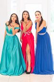 Three hispanic teen friends going to their prom poster