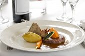 Gourmet Steak Dish In Restaurant