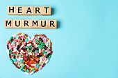 Heart Made Of Pills And Wooden Cubes On Color Background, Top View With Space For Text. Cardiology C poster