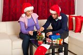Couple Eat  Cookies In Xmas Night