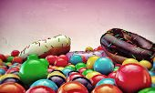 picture of gumballs  - donuts and gumballs isolated on pink background - JPG