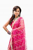 stock photo of bangla  - Beautiful Bengali bride in colorful dress isolated - JPG