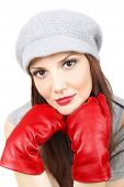 Beautiful woman wearing grey hat and red leather gloves