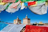 Prayer Flags Surround A Tibetan Monastery