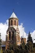 Old brick bells tower of Curtea de Arges Monastery