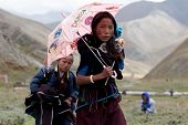 Tibetan woman with parasol
