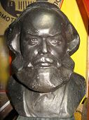 bronze Karl Marx bust in a museum