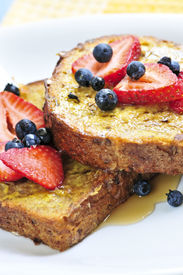 image of french toast  - Breakfast of french toast with fresh berries and maple syrup - JPG