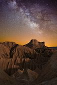 stock photo of sagittarius  - Milky Way over the desert of Bardenas Spain - JPG