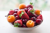 Assorted Colorful Fresh Summer Berries And Fruits - Apricots, Cherries And Strawberries