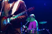 image of guitarists  - Guitarist on stage - JPG