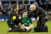 TWICKENHAM LONDON, 27/02/2010. Ireland captain Brian O'Driscoll gets treated by the Irish medical te
