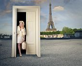 beautiful tourist opens a magic door and finds herself in Paris