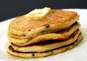 stock photo of chocolate-chip  - stack of chocolate chip pancakes with butter and syrup - JPG