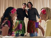 Two happy couples at dressing up party