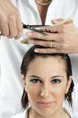 stock photo of hair cutting  - portrait of young woman having her hair being cut - JPG