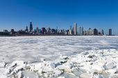 image of freezing temperatures  - Chicago downtown skyline in the winter with clear sky - JPG