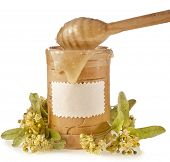 linden honey in birch barrel and honey stick isolated on white background