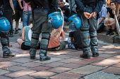 Riot police evacuates activists